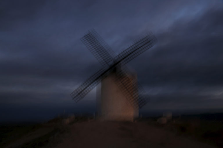 A windmill is seen at sunset in Consuegra, Spain, April 5, 2016. REUTERS/Susana Vera - RTX2AMMM
