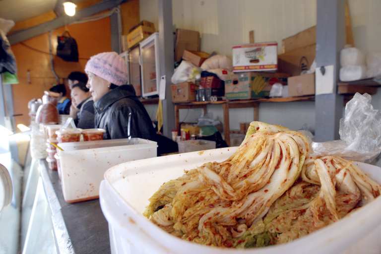 Ethnic Koreans sell kimchi, Korean pickled cabbage, at a market in Yuzhno-Sakhalinsk, Russia on Wednesday, Oct. 24, 2007.  (AP Photo/Burt Herman)