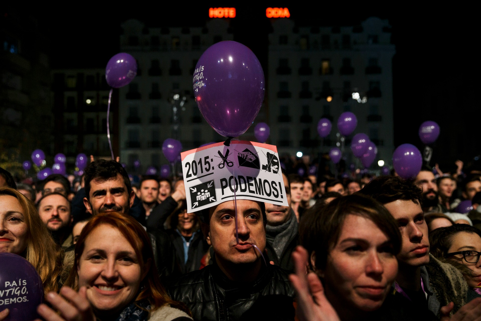 Supporters of the Podemos party wait for official results in Madrid, Sunday, Dec. 20, 2015. A strong showing by upstart parties Podemos and Ciudadanos is threatening to upend the country's traditional two-party system in Spain's general election, with exit polls and early results projecting that the ruling Popular Party won the most votes but fell far short of a parliamentary majority and risks being booted from power.(AP Photo/Daniel Ochoa de Olza)