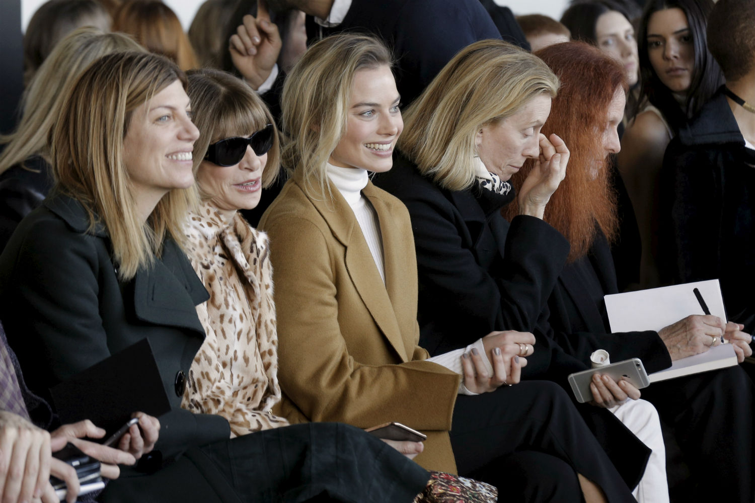 Vogue's Fashion Market/Accessories Director Virginia Smith, editor-in-chief Anna Wintour and actress Margot Robbie (L to R) attend the Calvin Klein Fall/Winter 2016 collection during New York Fashion Week in New York, February 18, 2016. REUTERS/Brendan McDermid